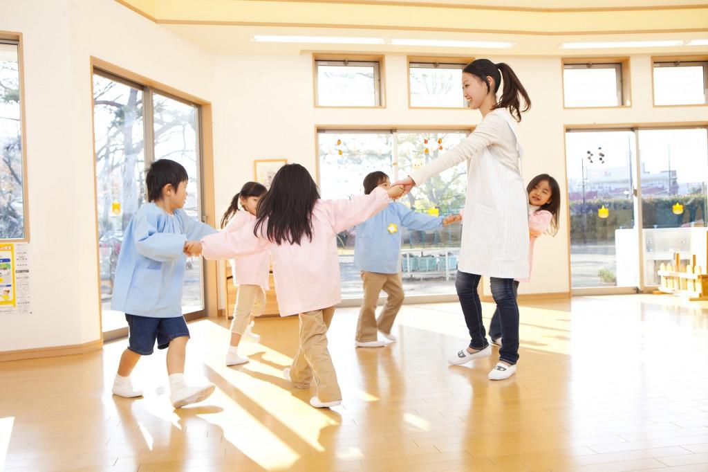 Preschool and kindergarten teachers, dancing in a circle