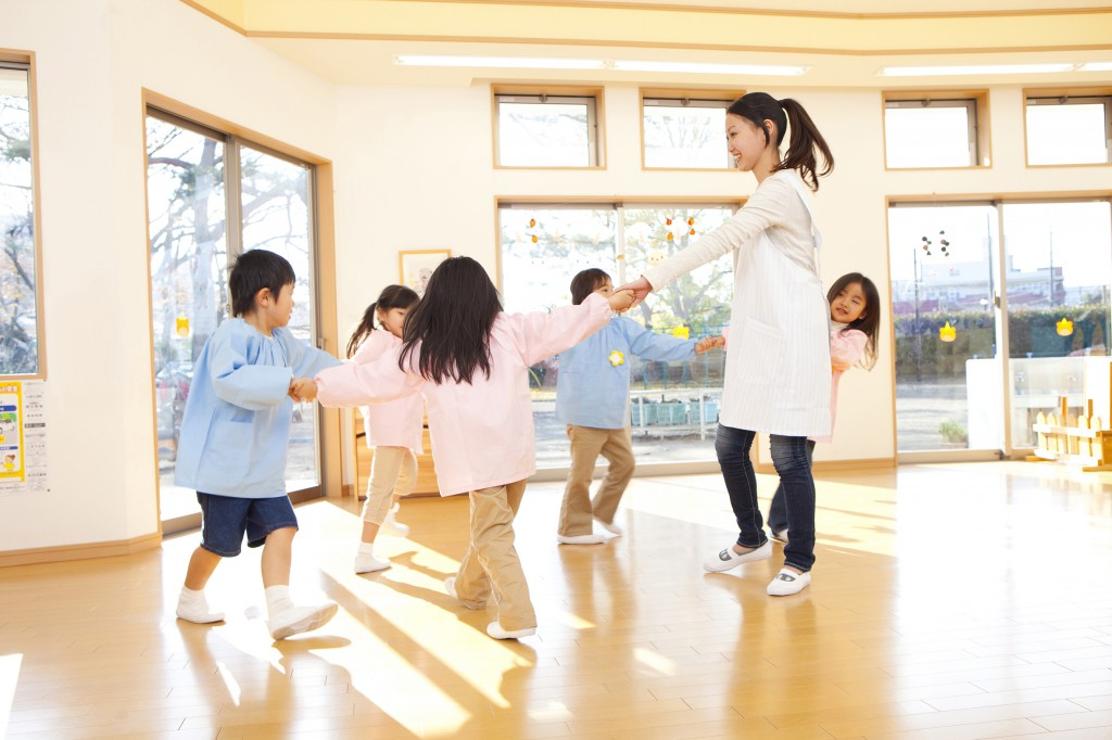 Preschool and kindergarten teachers, dancing in a circle
